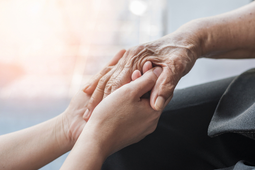 holding hands and caring for Alzheimer's