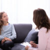 girl receiving mental health care at home