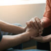 receiving mental health care while holding hands