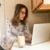 woman working from her computer while doing suboxone detox at home